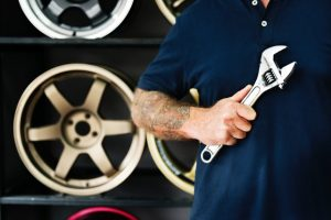 Customer service: Mechanic with wrench